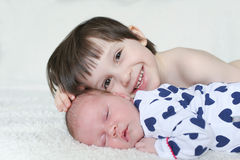 Portrait of happy brother and newborn sister Stock Photo