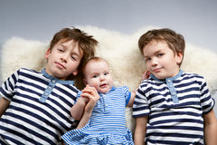 Portrait of happy brothers and cute small sister Royalty Free Stock Image