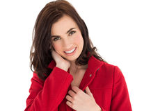Portrait of a happy brunette in red coat Stock Images