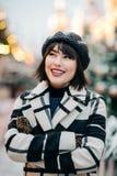Portrait of happy brunette on walk on street stock photography
