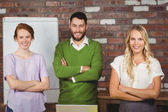 Portrait of happy business colleagues with arms crossed Royalty Free Stock Image