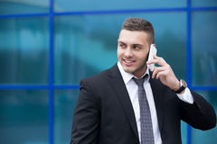 Portrait of happy business man on smartphone. Copy space Stock Images