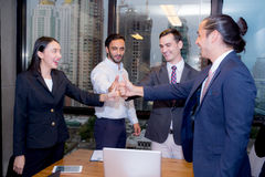 Portrait of happy business partners with geture teamwork. Royalty Free Stock Photos