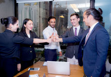 Portrait of happy business partners with smile and geture of teamwork. Stock Images
