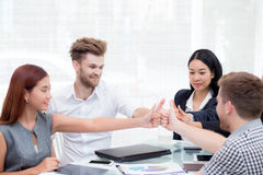Portrait of happy business partners with smiles and geture of team. Stock Images