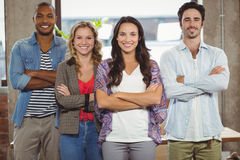 Portrait of happy business people with arms crossed in office Stock Photography