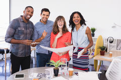 Portrait of happy business people holding document Stock Images