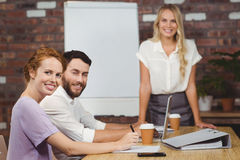 Portrait of happy business people during presentation in office Royalty Free Stock Images