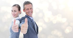 Portrait of happy business people showing thumbs up over bokeh Royalty Free Stock Photos