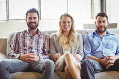 Portrait of happy business people sitting on sofa Royalty Free Stock Photography