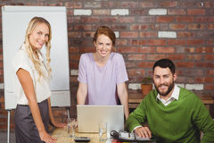 Portrait of happy business people smiling during discussion in office Royalty Free Stock Image