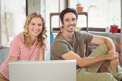Portrait of happy business people using computer in office Royalty Free Stock Images
