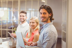 Portrait of happy business people working Royalty Free Stock Photos