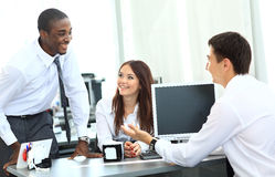 Portrait of happy business team. Having meeting in office Stock Photos