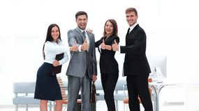 Portrait of happy business team. Showing thumb up Royalty Free Stock Photo