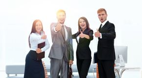 Portrait of happy business team. Showing thumb up Royalty Free Stock Photography