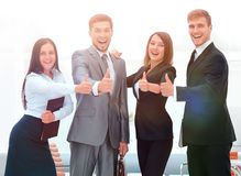 Portrait of happy business team. Showing thumb up Stock Photography