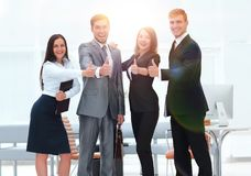 Portrait of happy business team. Showing thumb up Stock Image