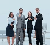 Portrait of happy business team. Showing thumb up Stock Images