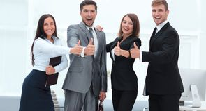 Portrait of happy business team. Showing thumb up Royalty Free Stock Photos