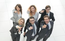 Portrait of happy business team showing thumbs up. Photo with copy space Stock Image