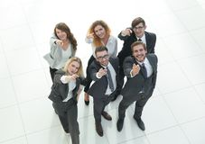 Portrait of happy business team showing thumbs up. Photo with copy space Royalty Free Stock Image