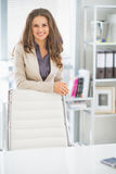 Portrait of happy business woman in office Stock Images