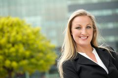 Portrait of a happy business woman outdoors Stock Images