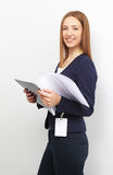 Portrait of happy business woman with papers over white backgrou Royalty Free Stock Photos