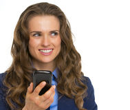 Portrait of happy business woman with phone Stock Photo