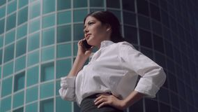 Portrait of happy business woman talking on the phone outdoors. On a sunny day stock footage