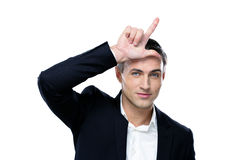 Portrait of a happy businessman gesturing Stock Photography