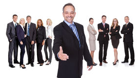 Portrait of happy businessman and his team Stock Photography