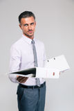 Portrait of a happy businessman holding folders Royalty Free Stock Photos