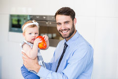 Portrait of happy businessman playing with daughter Stock Photo