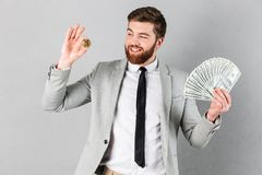 Portrait of a happy businessman showing bitcoin Royalty Free Stock Photo