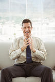 Portrait of happy businessman sitting on couch Royalty Free Stock Photo