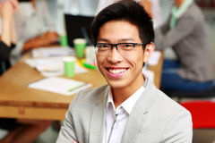 Portrait of happy businessman sitting in front Stock Photography