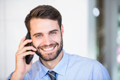 Portrait of happy businessman talking on mobile phone Stock Images