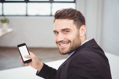 Portrait of happy businessman using mobile phone Royalty Free Stock Photography