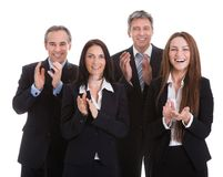 Portrait of happy businesspeople clapping Royalty Free Stock Photo