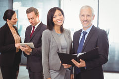 Portrait of happy businesspeople with a file Royalty Free Stock Photography
