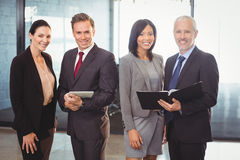 Portrait of happy businesspeople with file and digital tablet Royalty Free Stock Photos