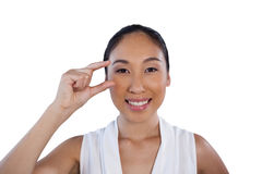 Portrait of happy businesswoman adjusting invisible eyeglasses Stock Images
