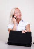 Portrait of happy businesswoman calling by mobile. Portrait of happy blonde calling by mobile in her office Royalty Free Stock Photos