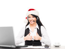Portrait of a happy businesswoman in a Christmas hat Royalty Free Stock Photos