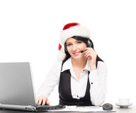 Portrait of a happy businesswoman in a Christmas hat Stock Photography
