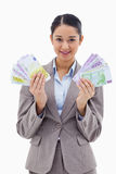 Portrait of a happy businesswoman holding bank notes Royalty Free Stock Photography