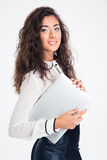 Portrait of a happy businesswoman holding laptop Royalty Free Stock Images