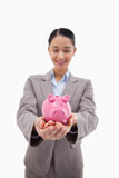 Portrait of a happy businesswoman holding a piggy bank Stock Photo